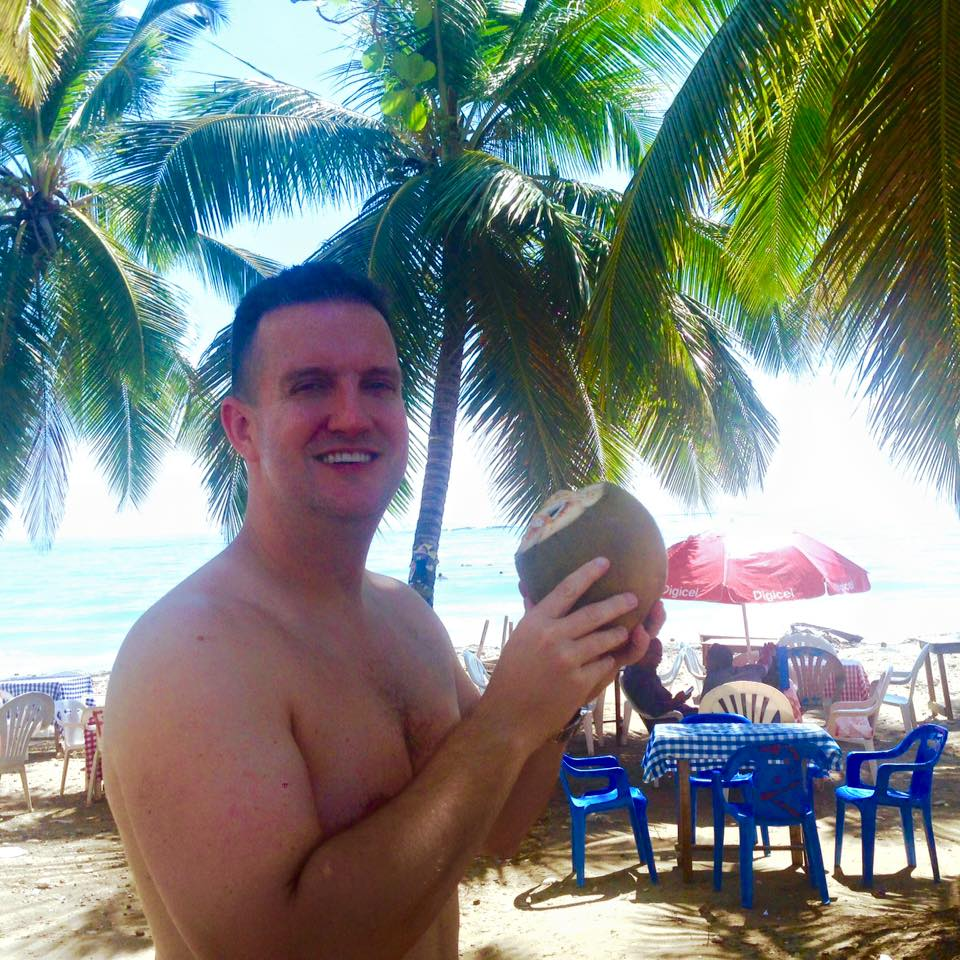 Drinking fresh coconut water at the beach