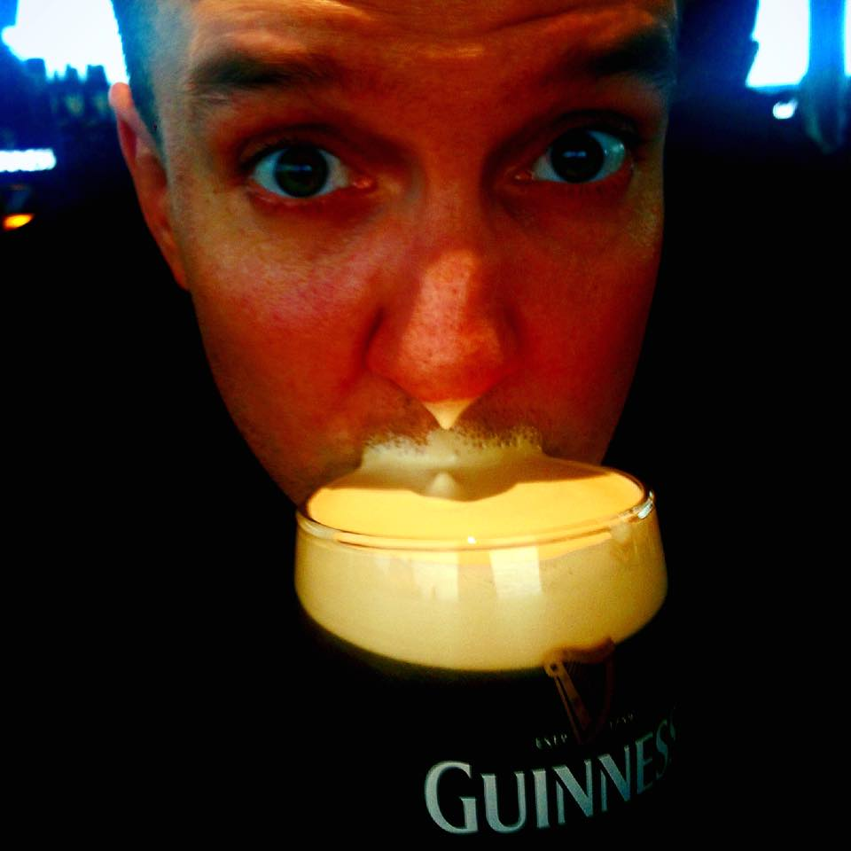 Some Irish guy getting head - also, Guinness