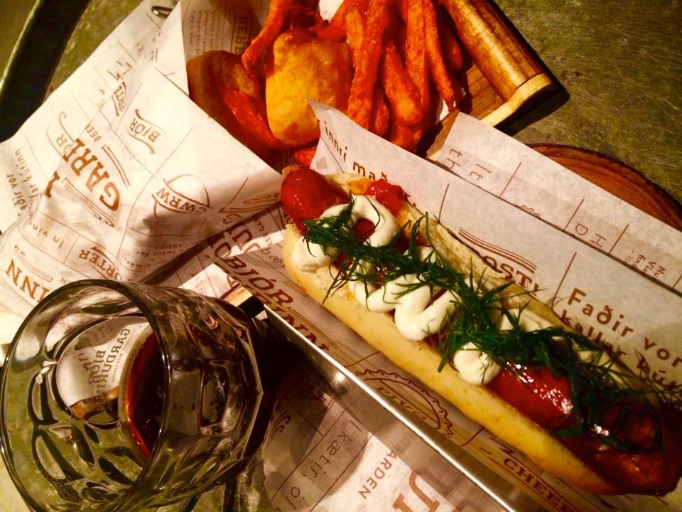 Thanksgiving dinner: gourmet dog with fresh peppers and dill, fish and chips, Icelandic beer