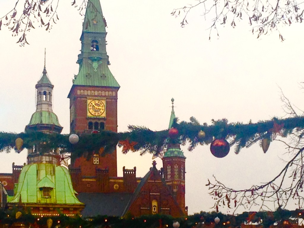 A glimpse of the World Clock at City Hall from Tivoli Gardens